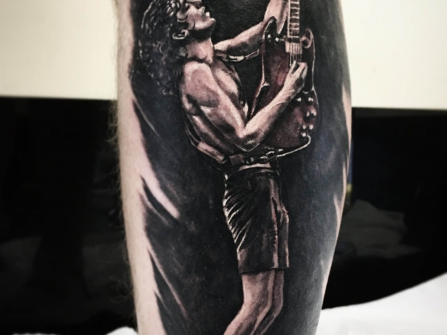 ACDC realistic black and grey tattoo on leg