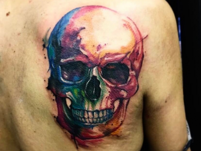 Abstract skull tattoo on back in colour whater colour