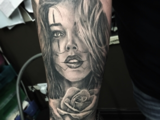 Black & Grey Tattoo clown girl face with rose tattoo sleeve