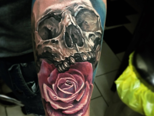 Realistic Skull with Rose colour tattoo on arm