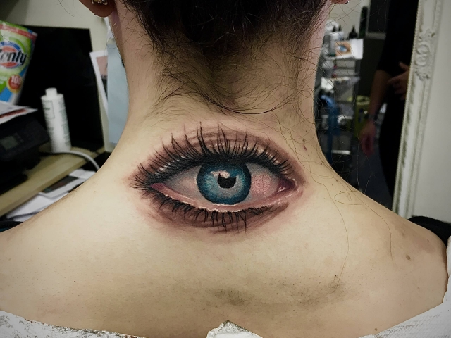 Realistic eye colour tattoo on neck 3D tattoos